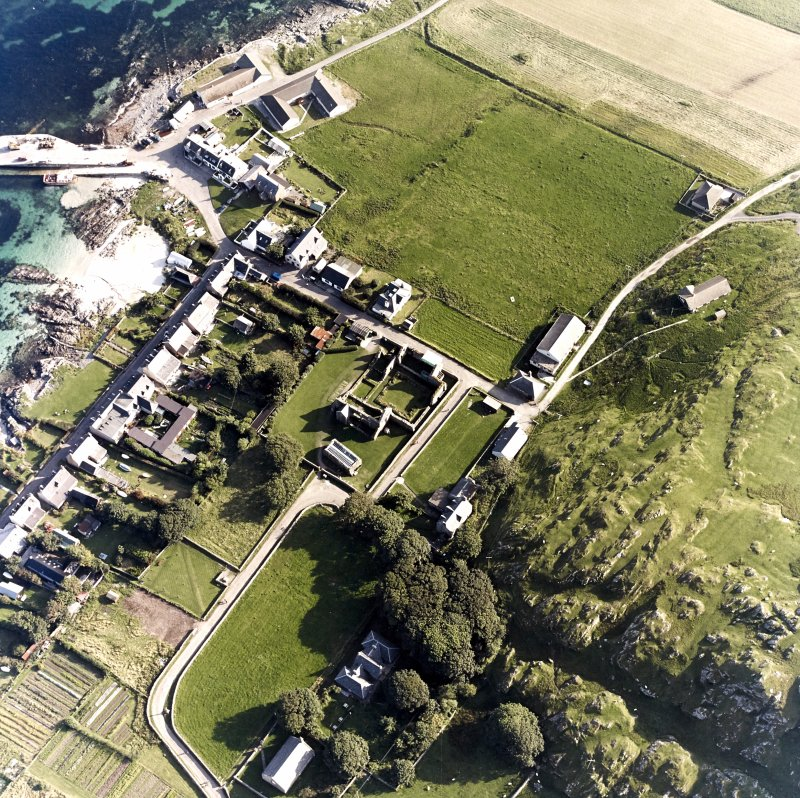 Iona, Baile Mor, Manse, Nunnery & Abbey. Oblique aerial view from North-West.