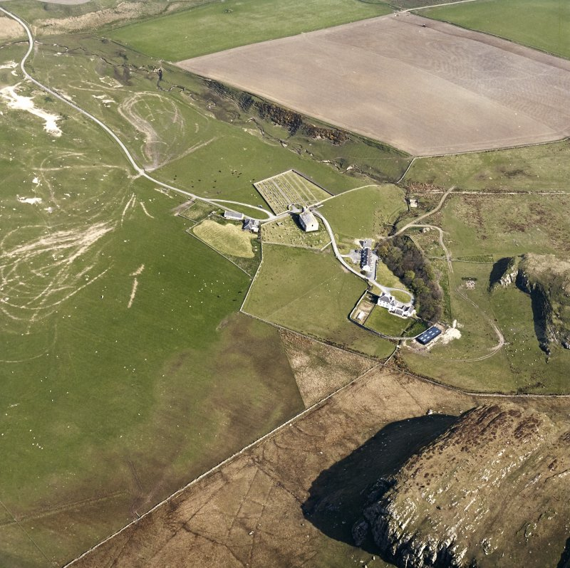 Oblique aerial view of Kilchoman centred on the church, burial-grounds and manse, taken from the S.
