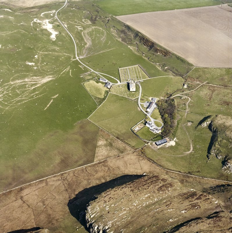 Oblique aerial view of Kilchoman centred on the church, burial-grounds and manse, taken from the SSE.