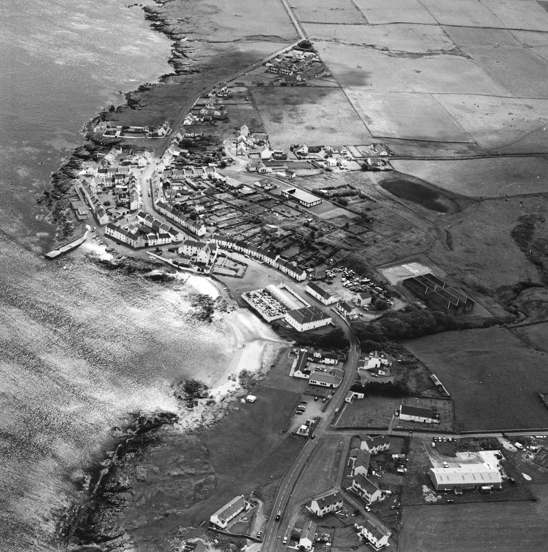 Oblique aerial photograph of Port Charlotte, Islay, taken from the NNE.
