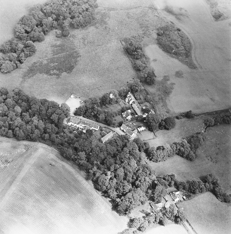 Oblique aerial view centred on the church, churchyard and hotel, taken from the WSW.