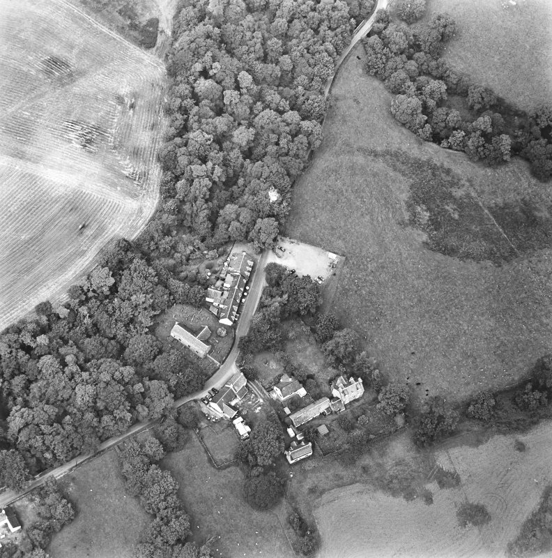 Oblique aerial view centred on the church, churchyard and hotel, taken from the SE.