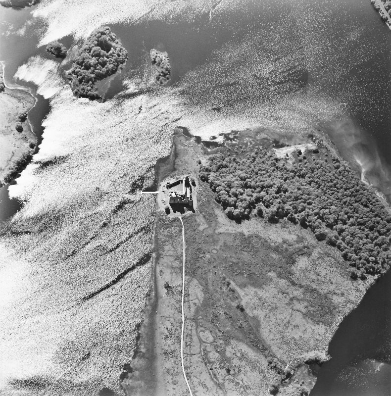Oblique aerial view centred on the remains of the castle, taken from the ENE.
