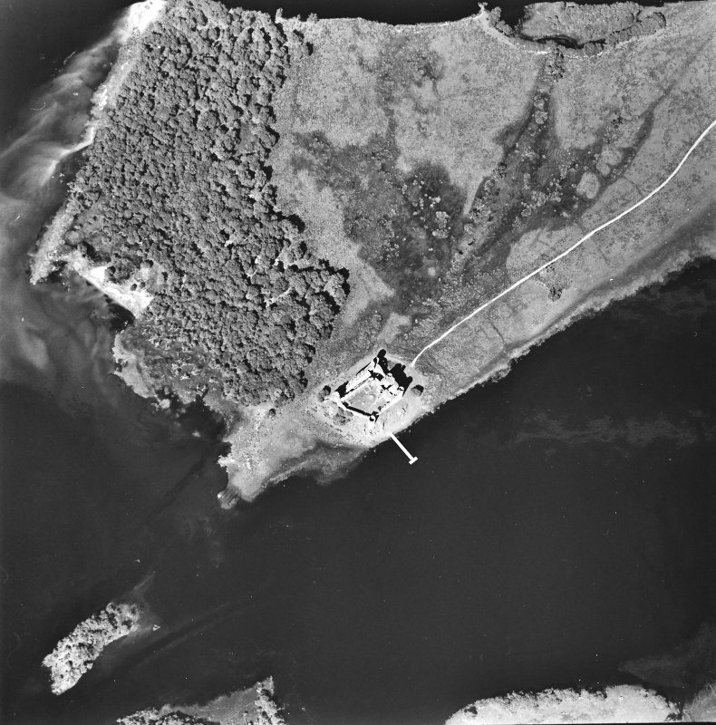 Oblique aerial view centred on the remains of the castle, taken from the S.