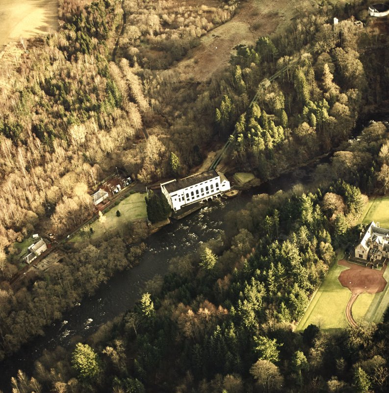 Oblique aerial view centred on Bonnington power station with pavilion adjacent, taken from the WNW.