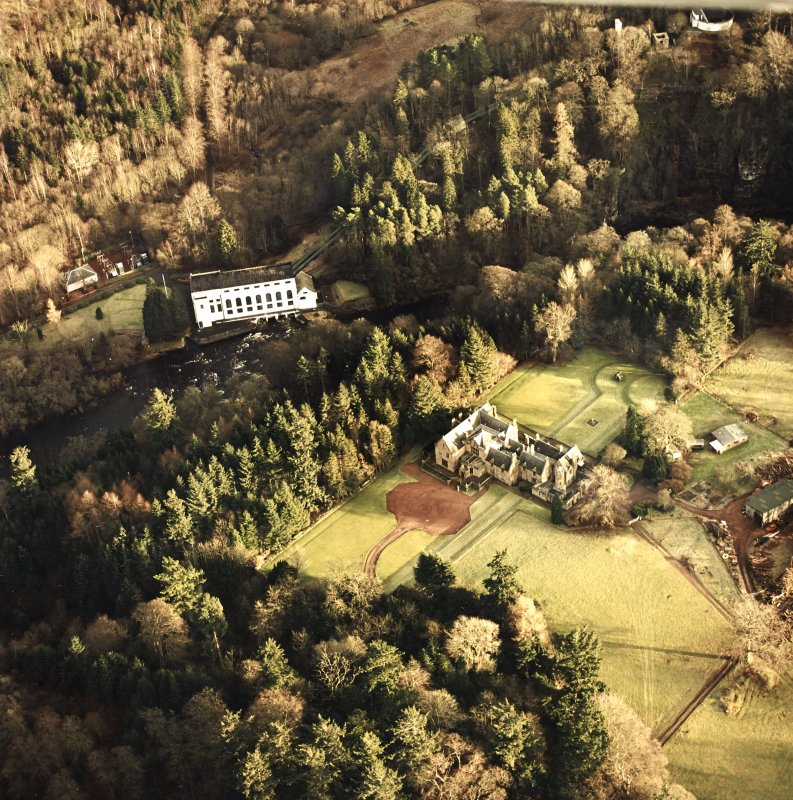 Oblique aerial view centred on Corehouse with power station and pavilion adjacent, taken from the W.