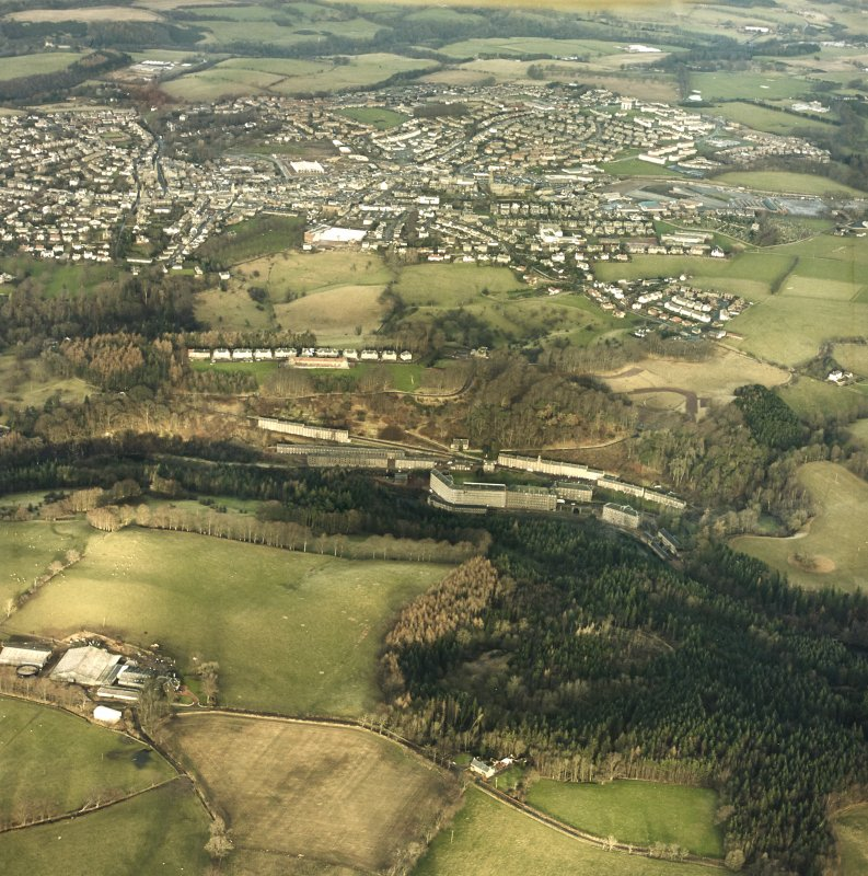 Oblique aerial view centred on New Lanark with the town of Lanark adjacent, taken from the SSW.