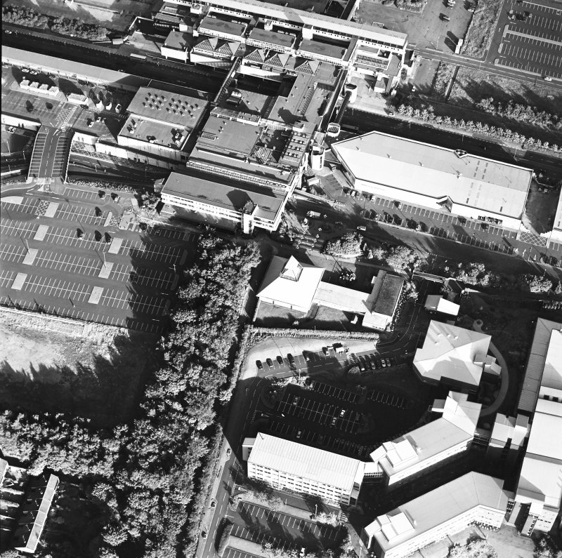 Oblique aerial view of Cumbernauld centred on St Mungo's Church in the town centre, taken from the WNW and recorded as part of the World of Worship project.