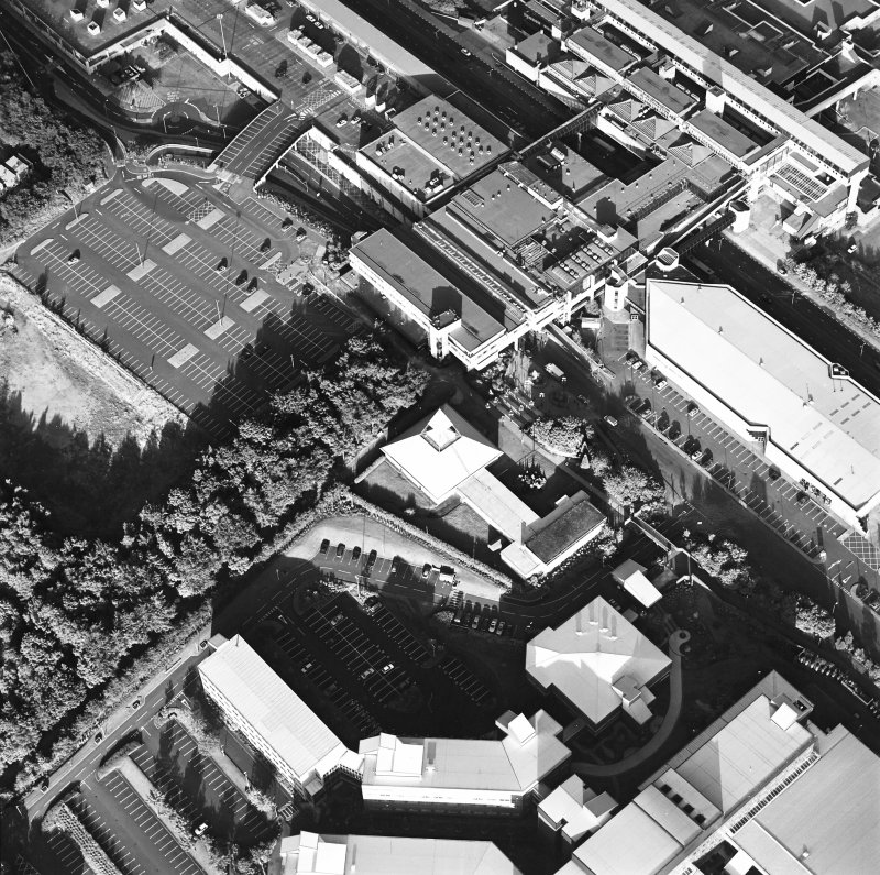 Oblique aerial view of Cumbernauld centred on St Mungo's Church in the town centre, taken from the W and recorded as part of the World of Worship project.