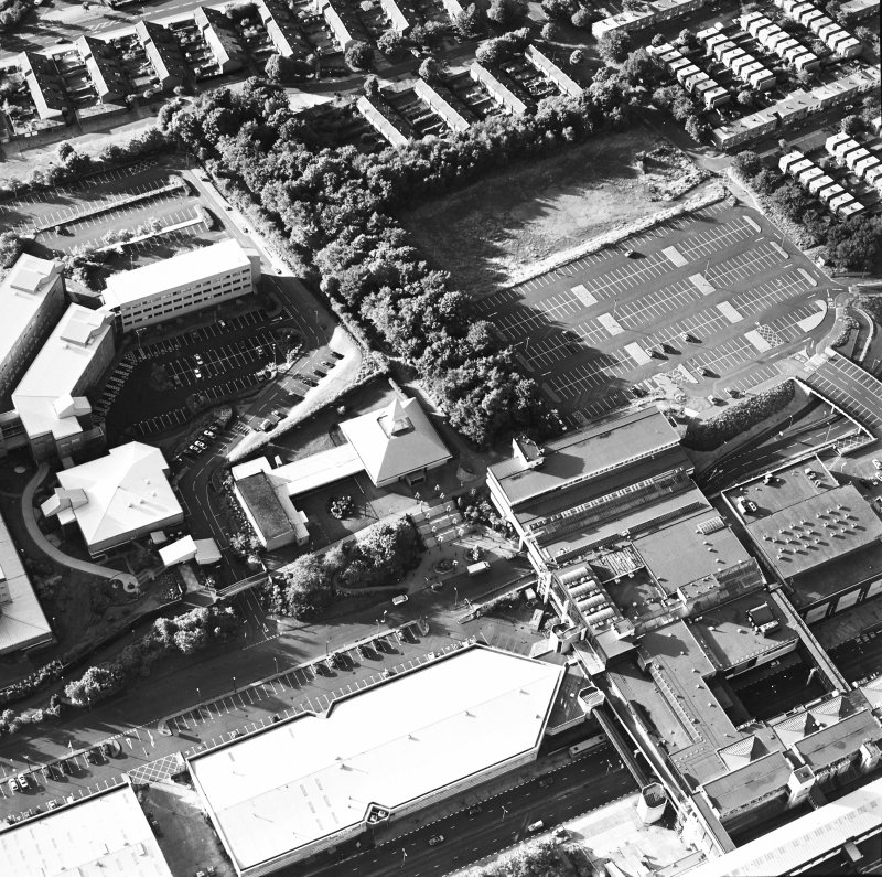 Oblique aerial view of Cumbernauld centred on St Mungo's Church in the town centre, taken from the SSE and recorded as part of the World of Worship project.