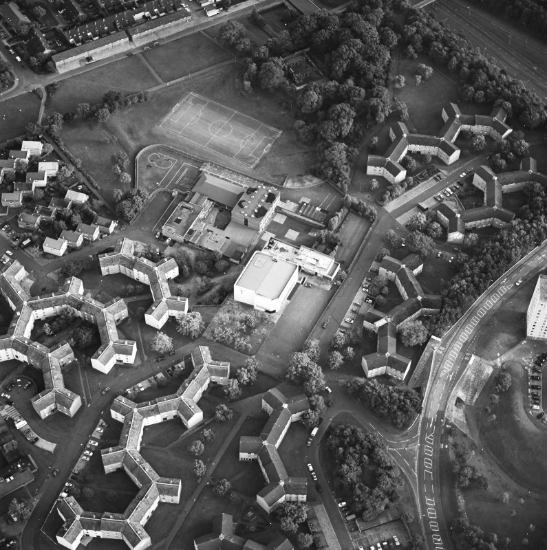 Oblique aerial view of Cumbernauld centred on sacred Heart Roman Catholic Church with the Sacred Heart Roman Catholic Primary School adjacent, taken from the N and recorded as part of the World of Worship project.