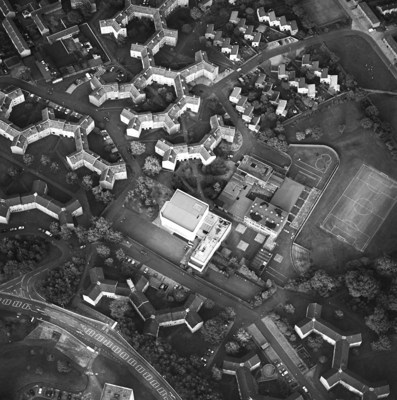 Oblique aerial view of Cumbernauld centred on sacred Heart Roman Catholic Church with the Sacred Heart Roman Catholic Primary School adjacent, taken from the W and recorded as part of the World of Worship project.