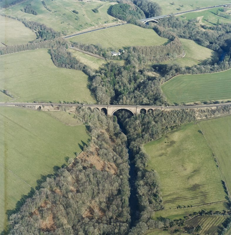 Oblique aerial view centred on the railway viaduct, taken from the WSW.