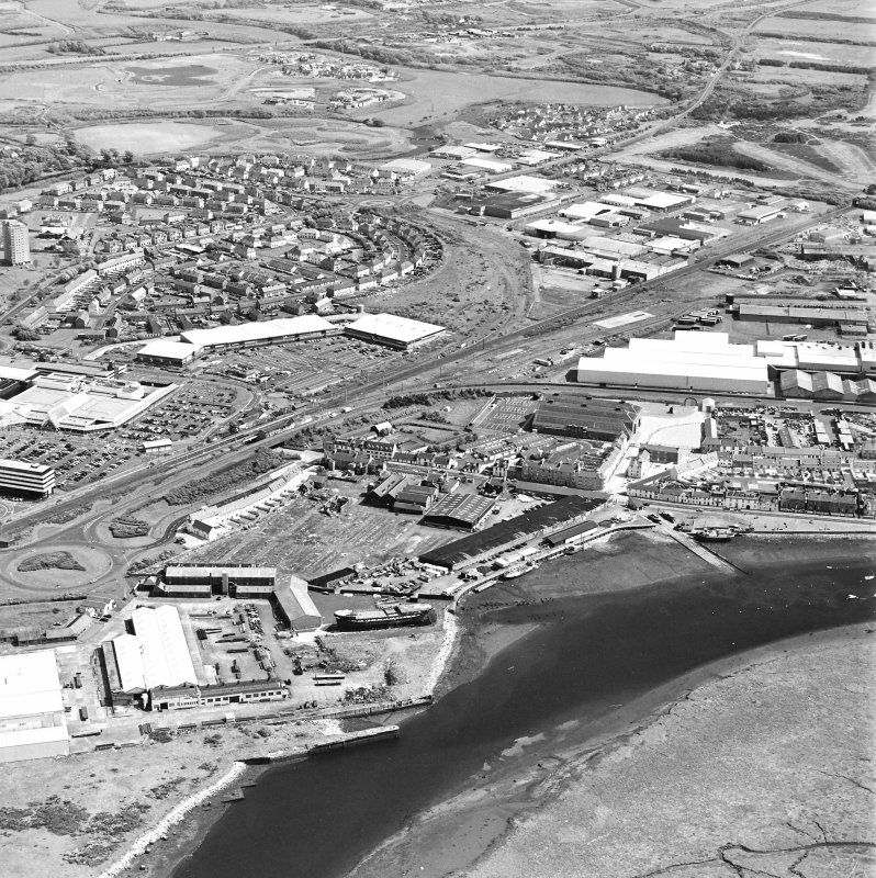Aerial view of Irvine Harbour, the Scottish Maritime Museum (including SV Carrick), the sawmill, Ayrshire Metal Products and Portland Road glass works, taken from the NW.