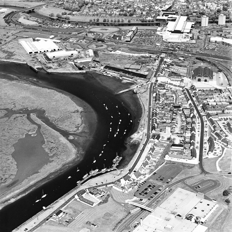 Aerial view of Irvine Harbour, the Scottish Maritime Museum (including SV Carrick), the sawmill and Ayrshire Metal Products, taken from the WSW.