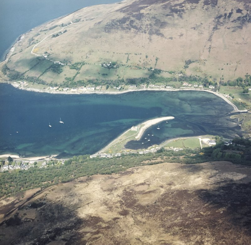 Oblique aerial view of Lochranza centred on the remains of the castle, taken from the SW.