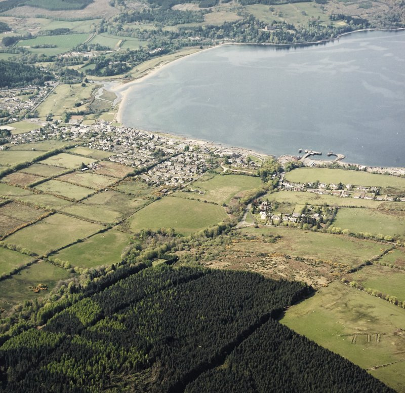 General oblique aerial view looking across the town and pier towards Brodick Bay with the country house beyond, taken from the SE.