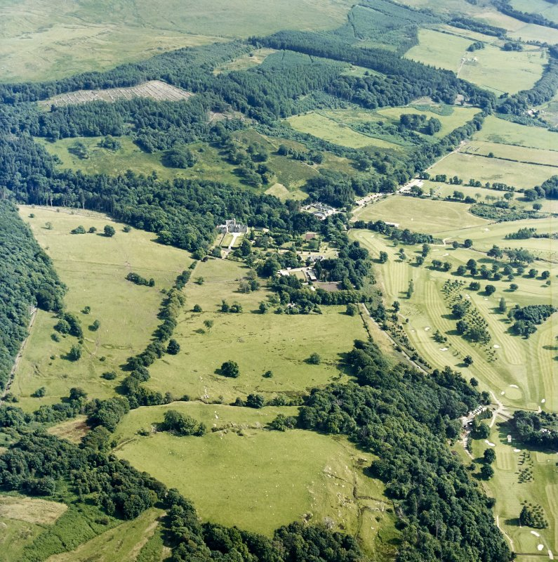 General oblique aerial view of the castle and golf course, taken from the NNW.