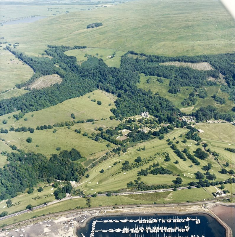 General oblique aerial view of the castle and golf course, taken from the WNW.
