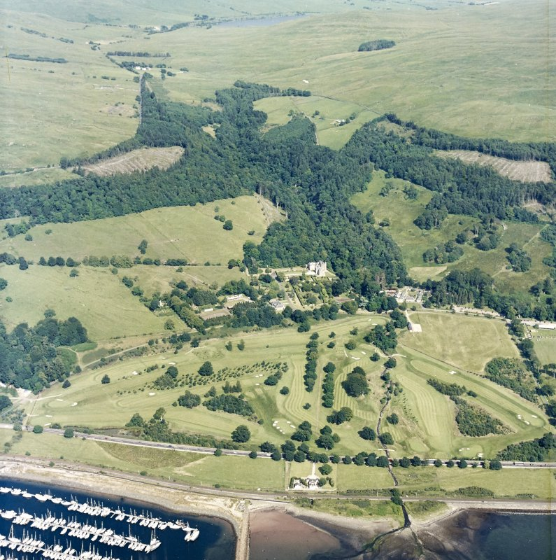 General oblique aerial view of the castle and golf course, taken from the WSW.