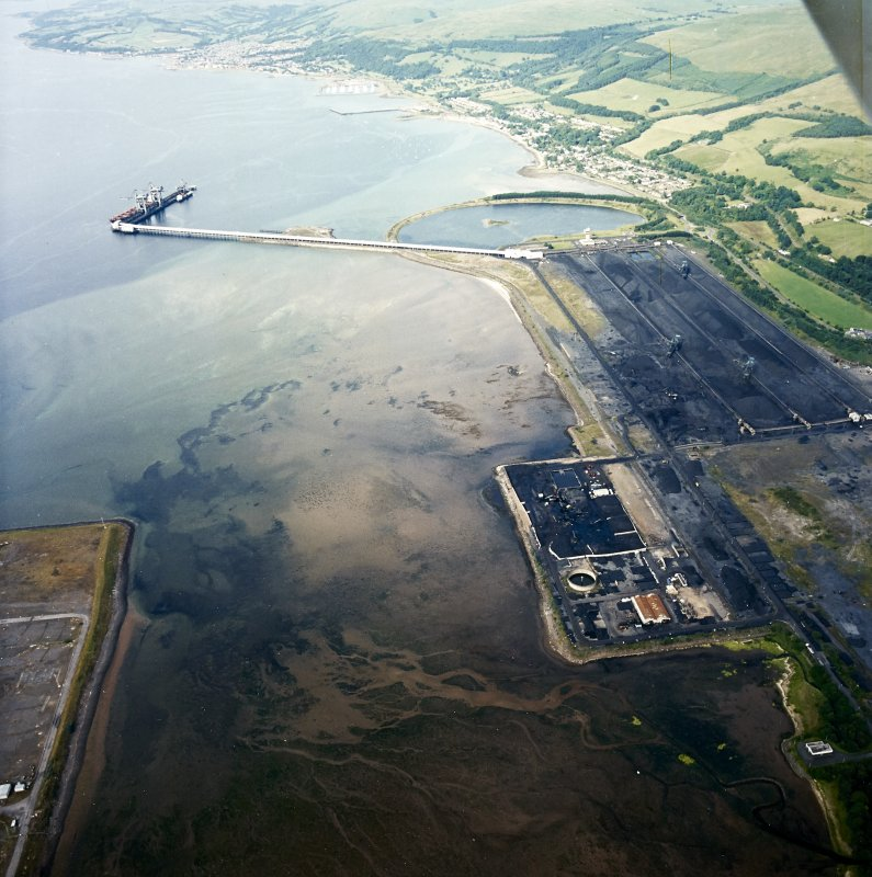 General oblique aerial view looking across the ore terminal towards Fairlie and Largs, taken from the SW.