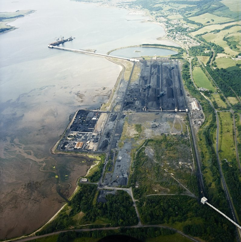 General oblique aerial view looking across the ore terminal towards Fairlie and Largs, taken from the S.