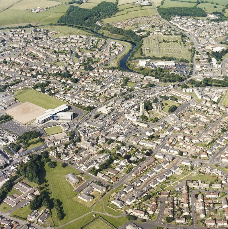 General oblique aerial view of the town centred on the abbey, taken from the SW.