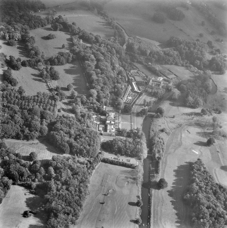 Glasgow, Pollok House. Oblique aerial view from North-West showing house, gateway, dovecot and castles.