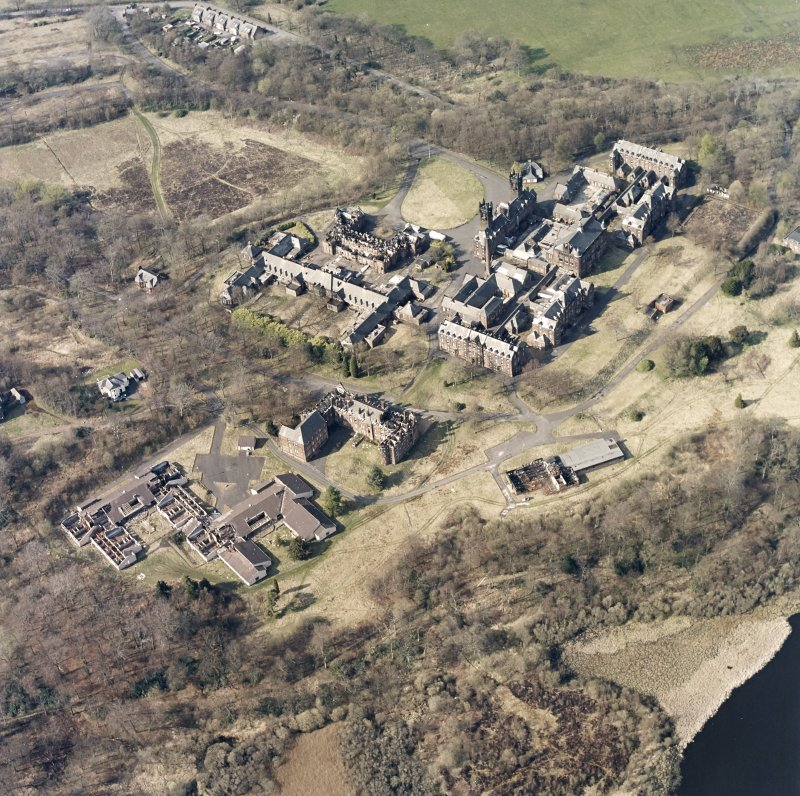 Oblique aerial view centred on the hospital, halls, nurses home, former mortuary, and workshops, taken from the S.