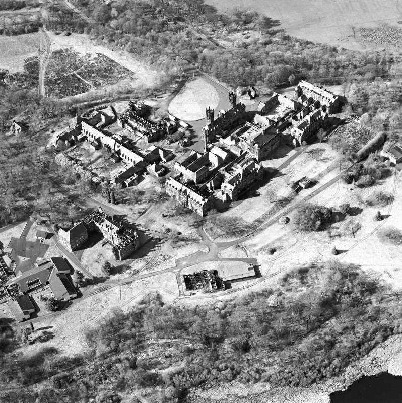 Oblique aerial view centred on the hospital, halls, nurses home, former mortuary, and workshops, taken from the SSE.