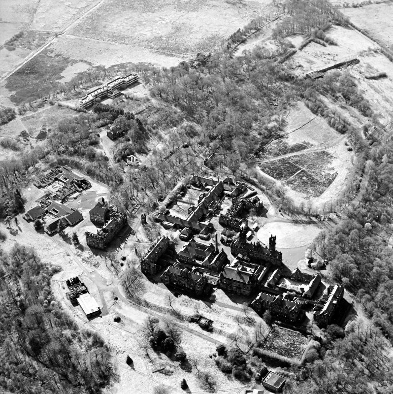 Oblique aerial view centred on the hospital, halls, nurses homes, former mortuary, and workshops, taken from the E.
