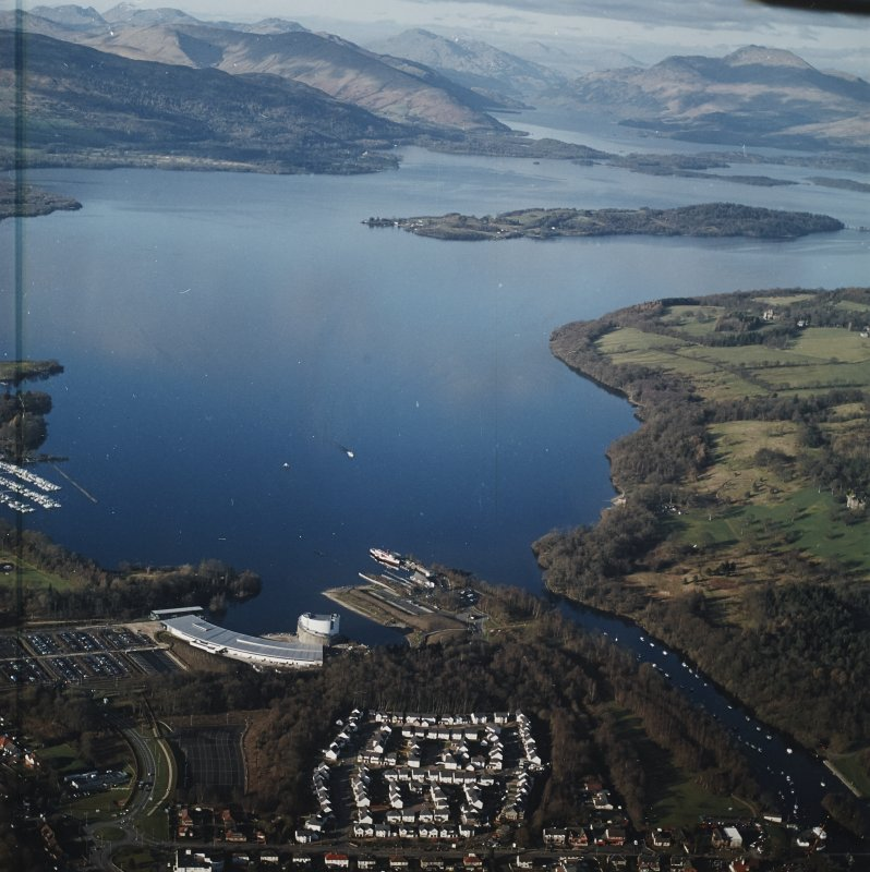 General oblique aerial view looking over the shopping centre, visitor centre, pier and slipway across Loch Lomond, taken from the SSE.