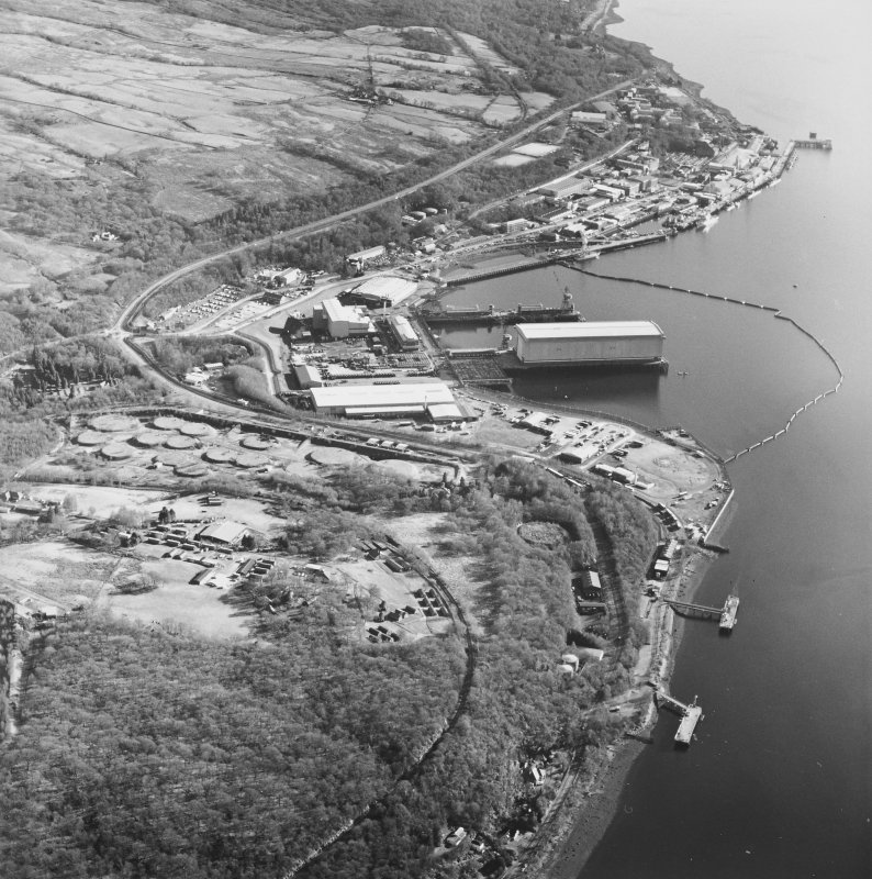 Oblique aerial view centred on the submarine base with the military training camp and oil fuel depot adjacent, taken from the NNW.