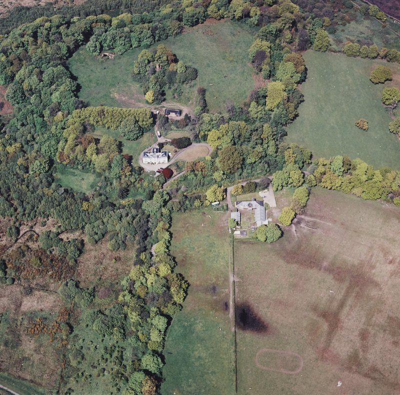 Oblique aerial view centred on the country house, stable, stable block and tower, taken from the SSE.