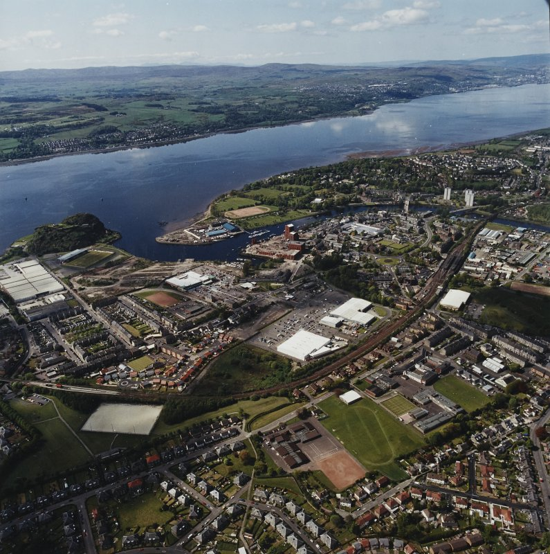 General oblique aerial view of Dumbarton looking across the school and whisky distillery towards the River Clyde, Langbank and Port Glasgow, taken from the ENE.