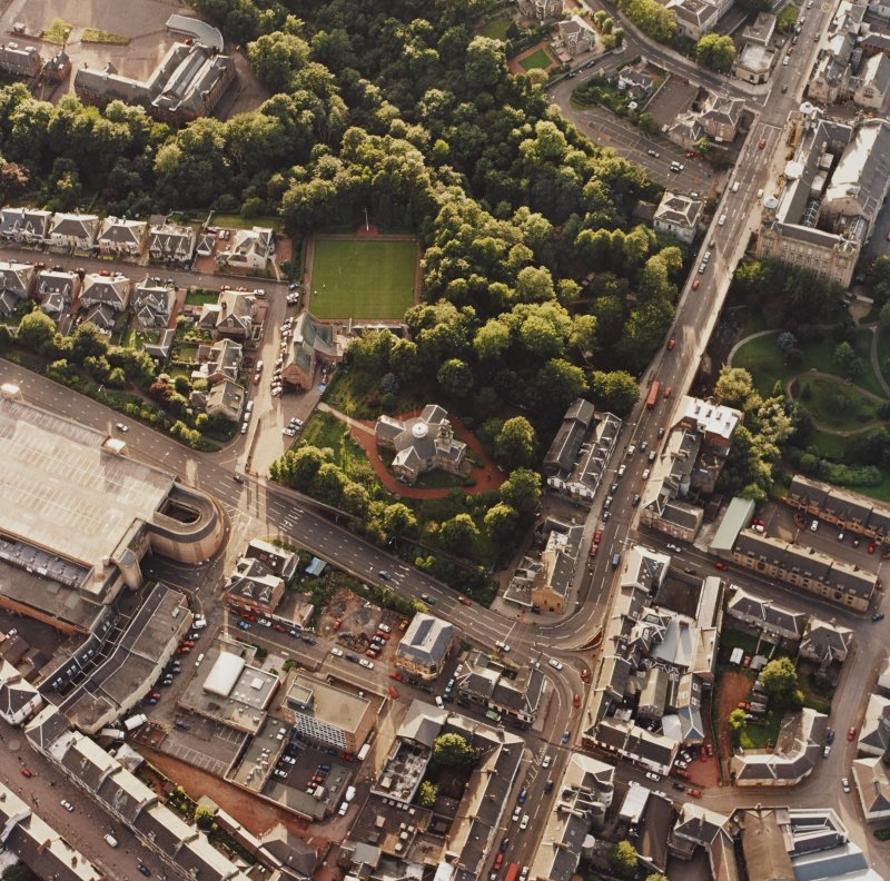 Oblique aerial view of Hamilton centred on Hamilton Parish Church with the halls adjacent, taken from the E.