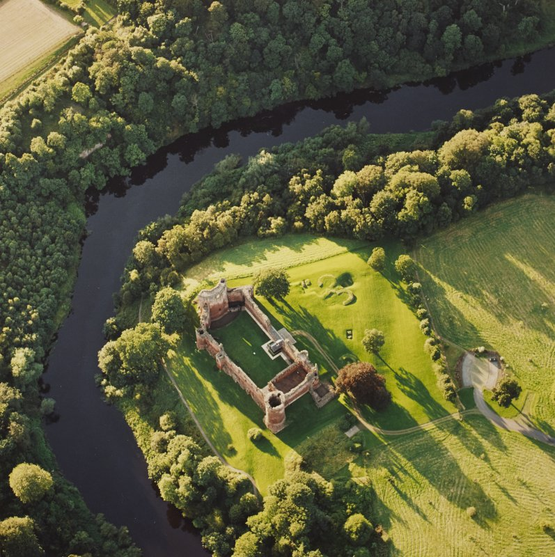 Oblique aerial view of Bothwell centred on the remains of the castle, taken from the SE.
