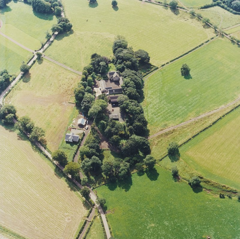 Oblique aerial view centred on the Museum of Scottish Country Life and farmsteading, taken from the NNW.