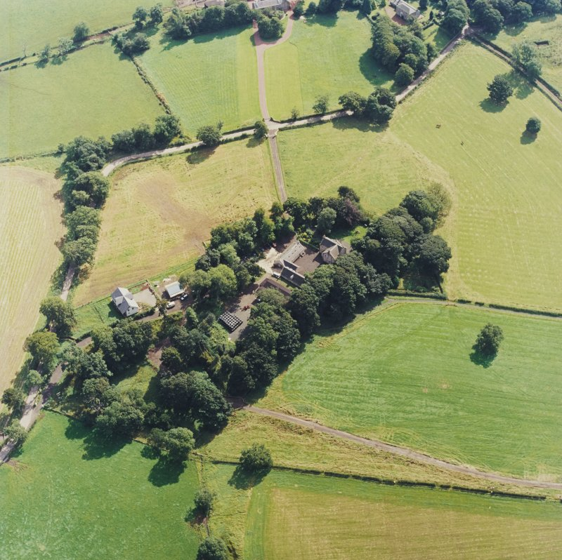 Oblique aerial view centred on the Museum of Scottish Country Life and farmsteading, taken from the WNW.
