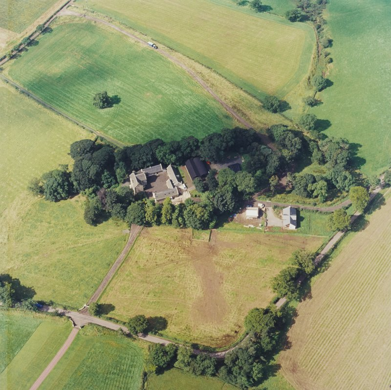Oblique aerial view centred on the Museum of Scottish Country Life and farmsteading, taken from the E.
