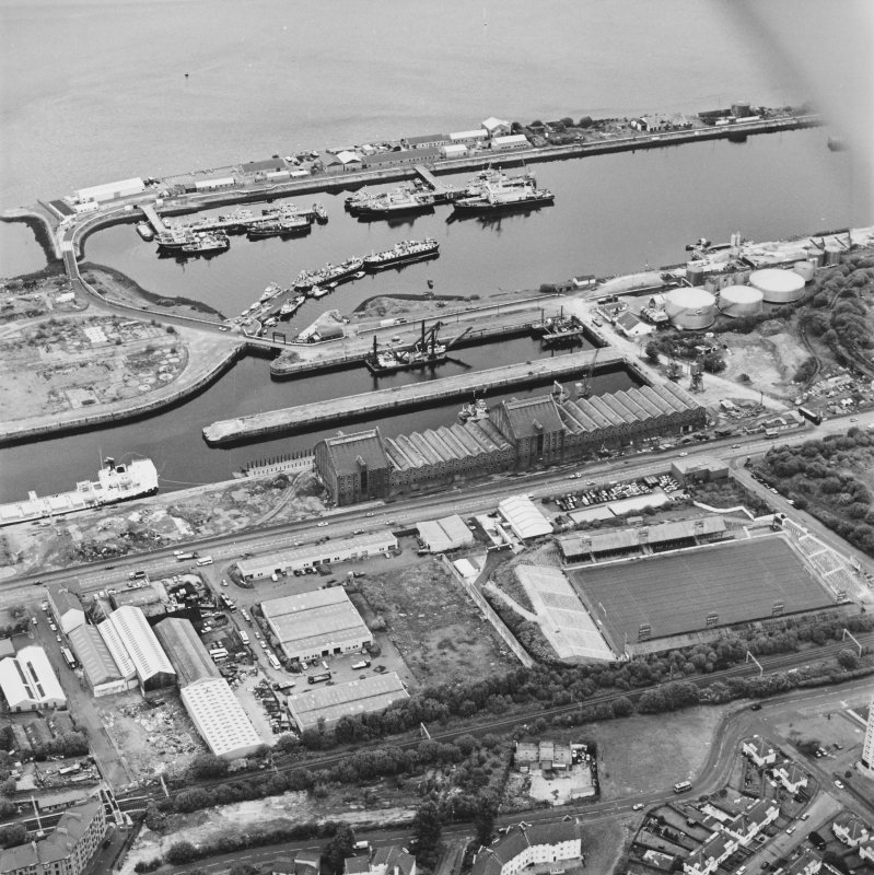 Greenock, James Watt Dock, oblique aerial view, taken from the SW. Cappielow is visible in the centre right of the photograph.