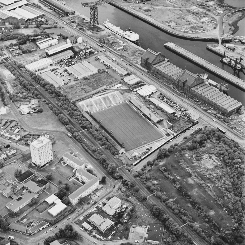 Greenock, James Watt Dock, oblique aerial view, taken from the S. Cappielow is visible in the centre of the photograph.