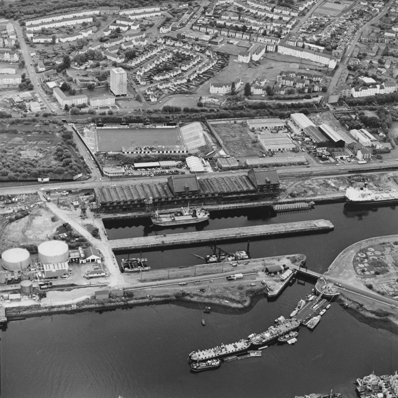 Greenock, James Watt Dock, oblique aerial view, taken from the NE. Cappielow is visible in the centre of the photograph.