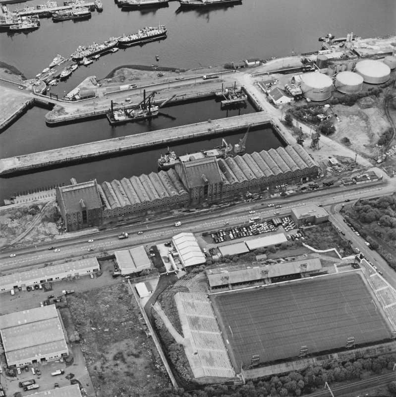 Greenock, James Watt Dock, oblique aerial view, taken from the SW. Cappielow is visible in the bottom half of the photograph.
