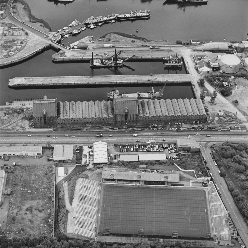 Greenock, James Watt Dock, oblique aerial view, taken from the SSW. Cappielow is visible in the bottom half of the photograph.
