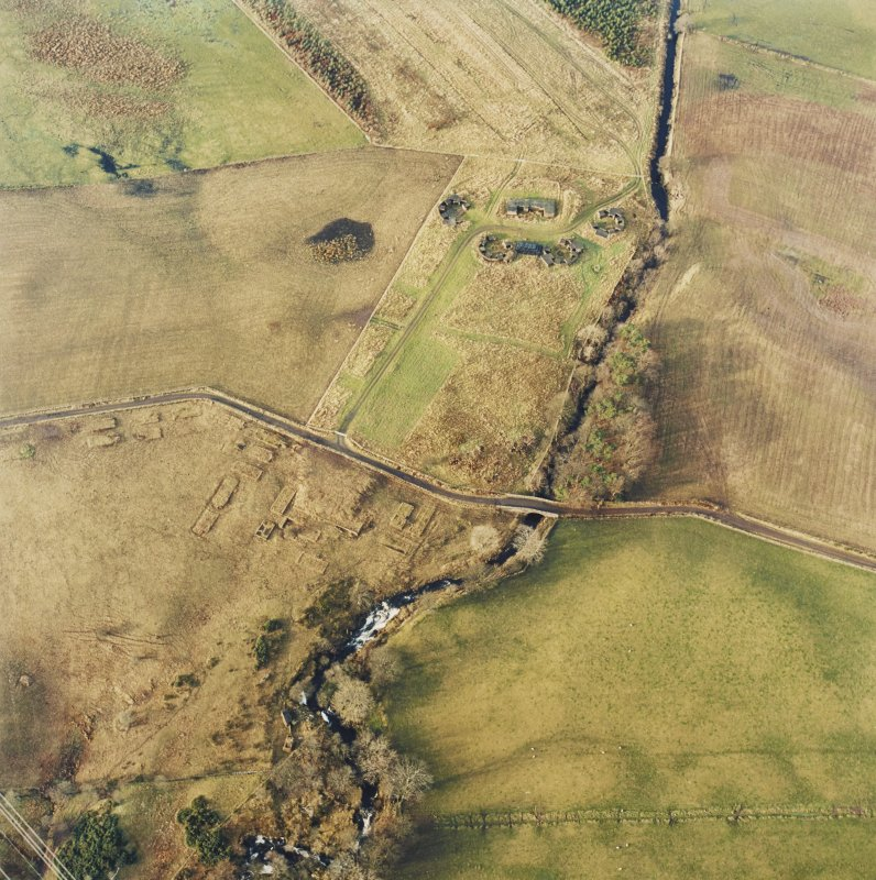 Oblique aerial centred on the remains of the anti-aircraft battery, taken from the ESE.