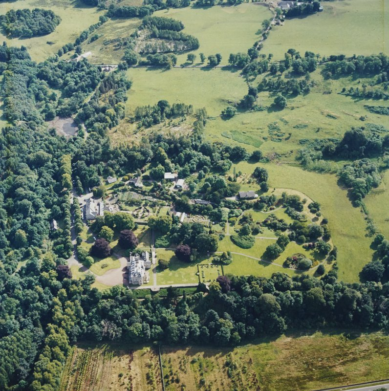 Oblique aerial view centred on the house, taken from the NNE.