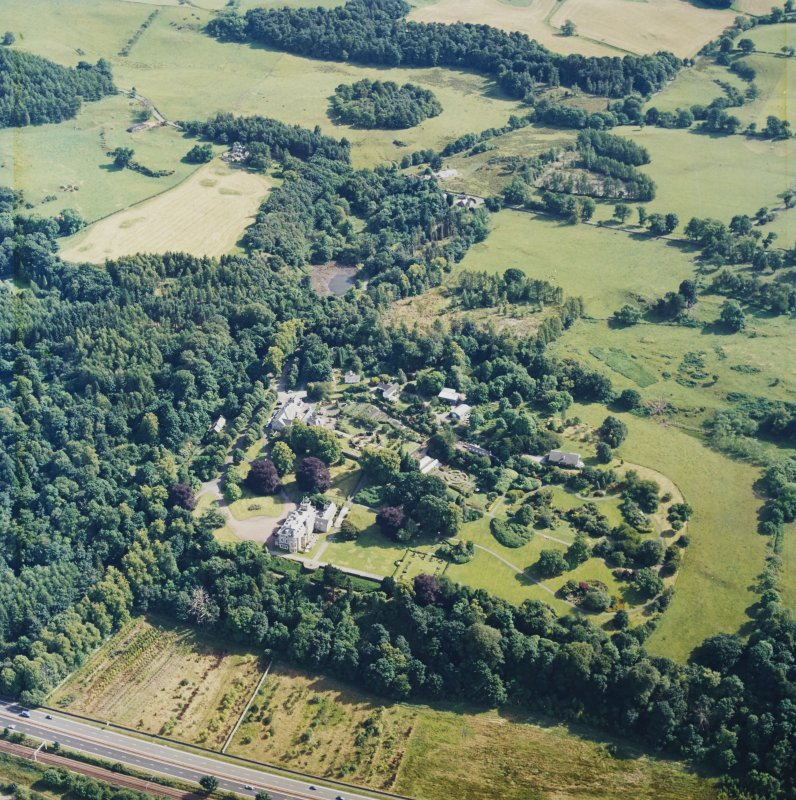 Oblique aerial view centred on the housel, taken from the N.
