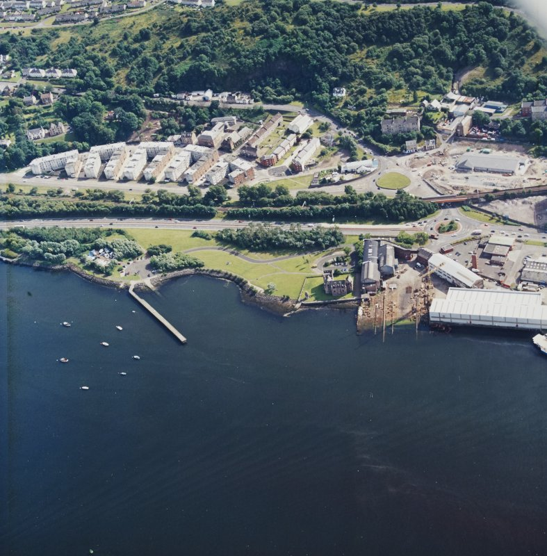 Oblique aerial view centred on the castle and shipyard, taken from the NNE.