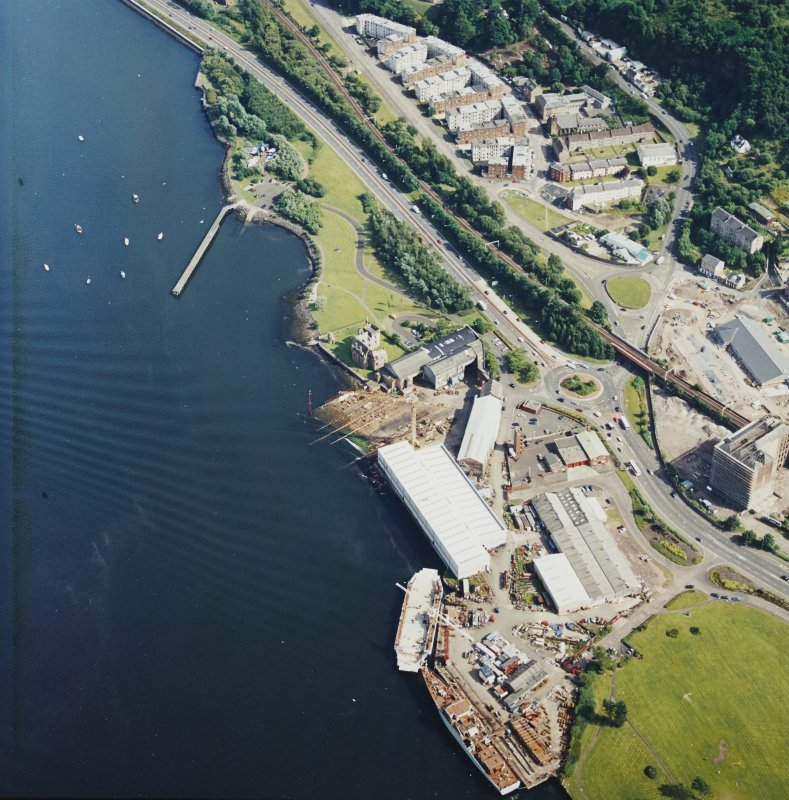 Oblique aerial view centred on the castle and shipyard, taken from the NW.